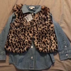 Cheetah vest with denim button up shirt.